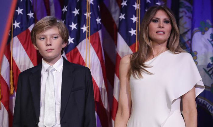 Barron Trump and his mother Melania Trump stand on stage after Republican president-elect Donald Trump delivered his acceptance speech at the New York Hilton Midtown in New York City on Nov. 9, 2016. (Chip Somodevilla/Getty Images)