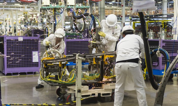 Workers at the assembly line of the Honda Motors factory in Celaya, Guanajuato state, Mexico, on Feb. 21, 2014. (OMAR TORRES/AFP/Getty Images)