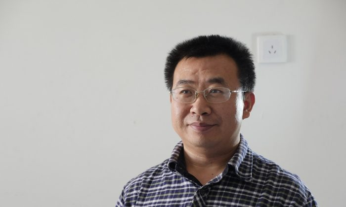 Chinese human rights lawyer Jiang Tianyong in a recent photo. Official Chinese media confirmed on Dec. 16 that Jiang was taken into custody. (Epoch Times)