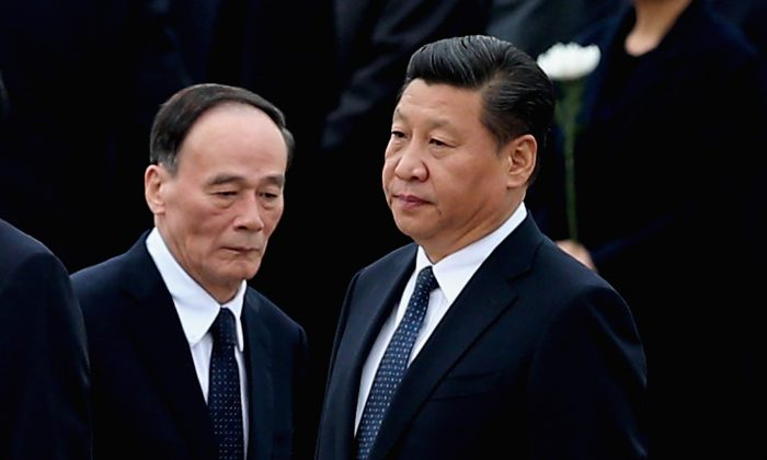 Chinese leader Xi Jinping (R) and former anti-corruption chief Wang Qishan in Beijing on Sept. 30, 2014. (Feng Li/Getty Images)