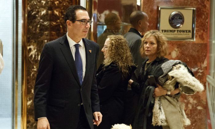 Steven Mnuchin, national finance chairman of President-elect Donald Trump's campaign, walks to lunch at Trump Tower in New York on Nov. 29, 2016. (AP Photo/Evan Vucci)