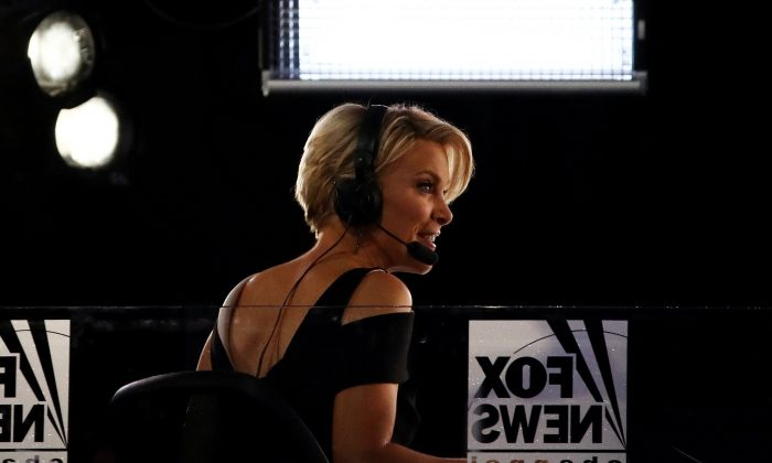 Fox News political commentator Megyn Kelly reports during the evening session on the fourth day of the Republican National Convention at the Quicken Loans Arena in Cleveland, Ohio on July 21, 2016. (Win McNamee/Getty Images)