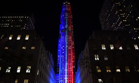 Rockefeller Center And Rockefeller Plaza Is Lit Up In Red And Blue To Mark The Electoral Progress Of Hillary Clinton And Donald Trump On Nov