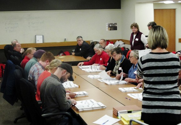 Ballots from the town of Middleton, Wis., are placed in front of workers as a statewide presidential election recount begins, in Madison, Wis., on Dec. 1, 2016. (AP Photo/Scott Bauer)