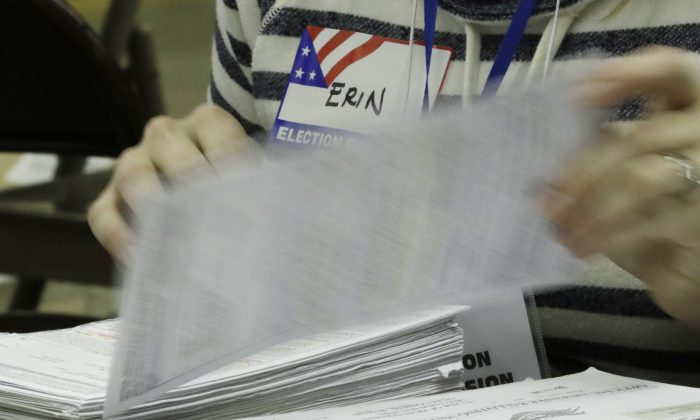 Workers begin a statewide presidential election recount Thursday, Dec. 1, 2016, in Milwaukee. (AP Photo/Morry Gash)
