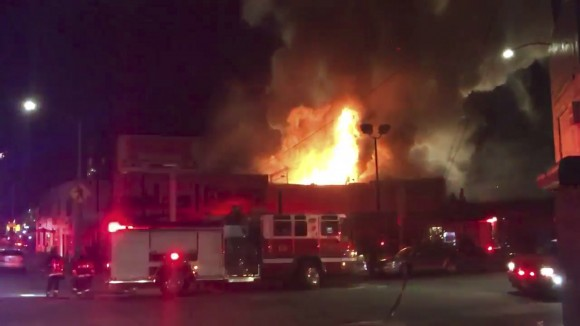 This photo of the Ghost Ship Arts Collective warehouse in Oakland from video provided by @Oaklandfirelive shows the scene of a fire in Oakland on Dec. 3, 2016. (@Oaklandfirelive via AP)