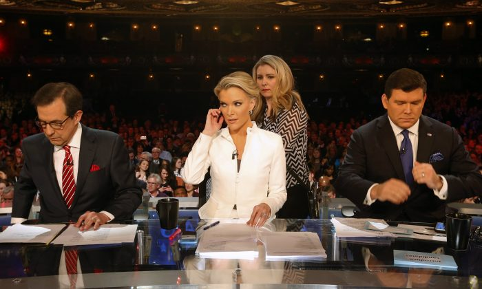 Moderators Bret Baier, Megyn Kelly and Chris Wallace take the stage before a Republican presidential primary debate at Fox Theatre on March 3, 2016, in Detroit. (AP Photo/Paul Sancya)