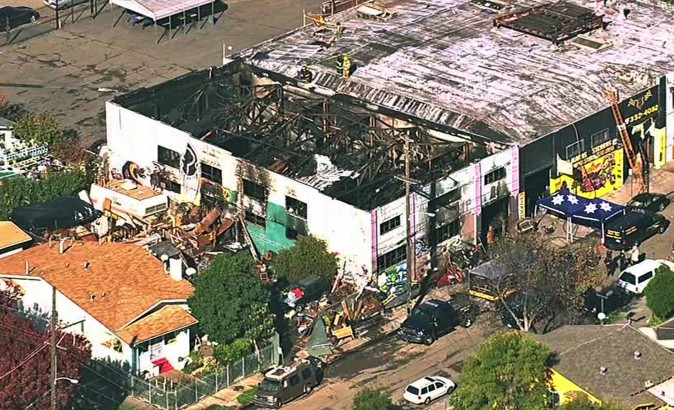The Ghost Ship Warehouse after a fire that started late Friday swept through the Oakland, Calif., building.  (KGO-TV via AP)
