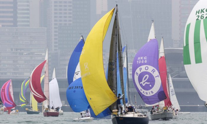 Yachts sailing down wind in the RHKYC's Lipton Trophy race, in Victoria Harbour, on Saturday Dec 3, 2016. (RHKYC/Guy Nowell)