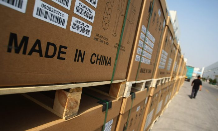 A man passes the photoelectric board products cased at the plant of Tianwei Yingli Green Energy Resources Co., Ltd on June 24, 2009 in Baoding, China. China is in no position to lead globalization in place of the United States, argues He Qinglian. (Feng Li/Getty Images)