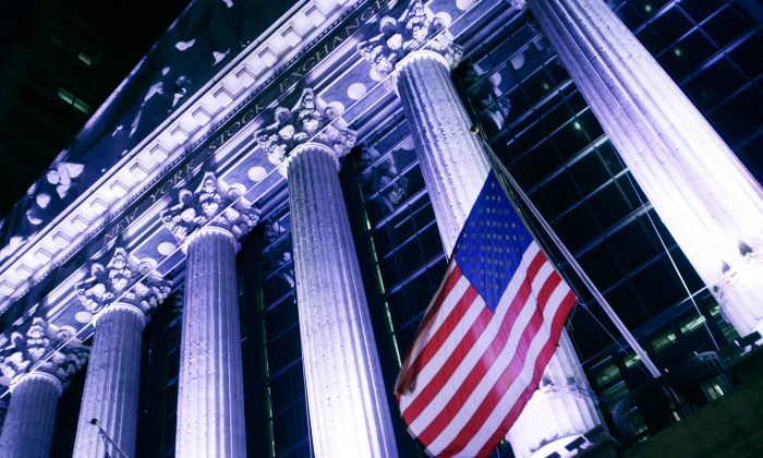 An American flag flies in front of the New York Stock Exchange. U.S. stocks are mixed on Dec. 7, 2016. (AP Photo/Mark Lennihan)