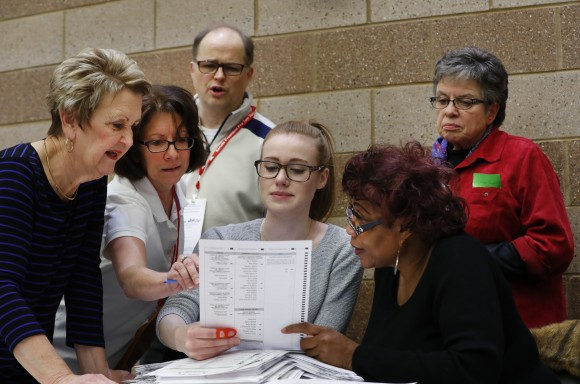 A challenge is reviewed on a ballot during a statewide presidential election recount in Waterford Township, Mich. on Dec. 5, 2016. The recount comes at the request of Green Party candidate Jill Stein who also requested recounts in Pennsylvania and Wisconsin. (AP Photo/Paul Sancya)