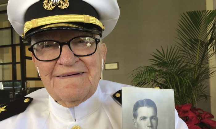 Jim Downing, 103, poses in a Navy uniform in Honolulu, on Dec. 5, 2016. (AP Photo/Audrey McAvoy)