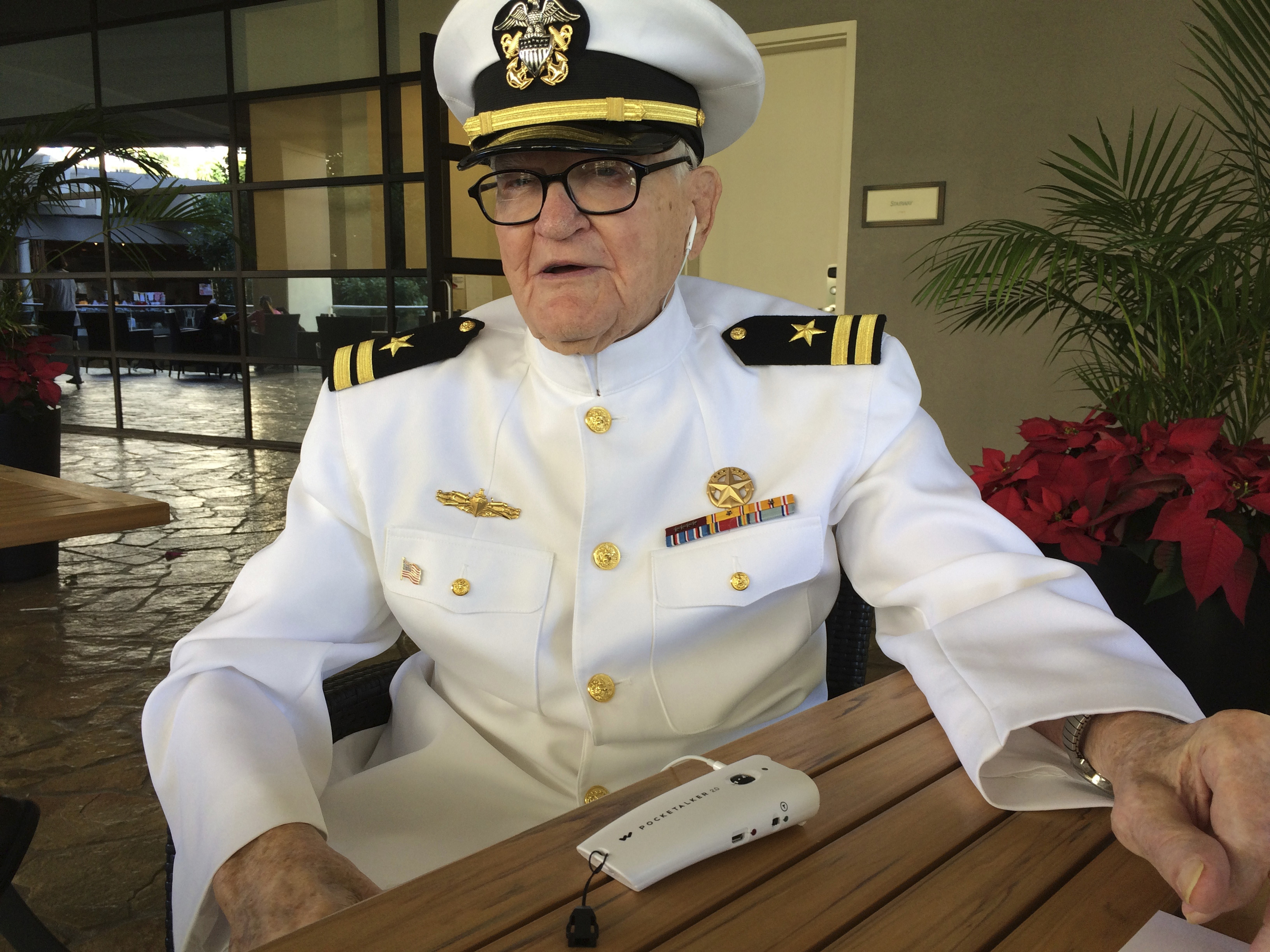 Jim Downing, 103, poses in a Navy uniform in Honolulu, on Dec. 5, 2016.(AP Photo/Audrey McAvoy)