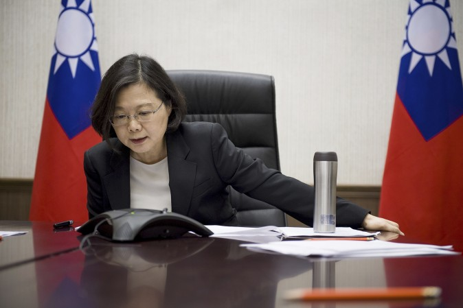 Taiwan's President Tsai Ing-wen speaks with President-elect Donald Trump through a speaker phone in Taipei, Taiwan, on Dec. 2.  (Taiwan Presidential Office via AP, File)