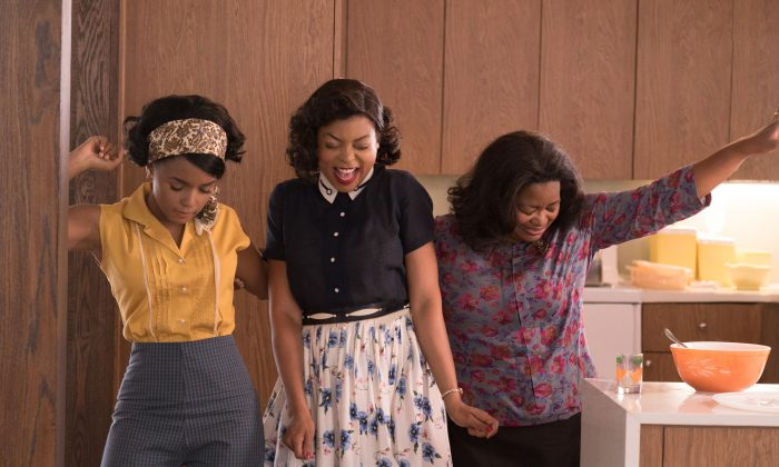 "(L–R) Mary Jackson (Janelle Monae, left), Katherine Johnson (Taraji P. Henson) and Dorothy Vaughan (Octavia Spencer) celebrate their stunning achievements in one of the greatest operations in history, in ""Hidden Figures."" (Hopper Stone/Twentieth Century Fox Film)."