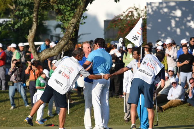 Miguel Angel Jimenez congratulates Rafa Cabrera Bello after completing their round on Day 2 of the UBS Hong Kong Open 2016, at Fanling on Friday Dec 9. (Bill Cox/Epoch Times)