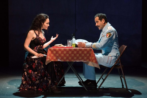 Café owner Dina (Katrina Lenk) and Colonel Tewfiq Zakaria (Tony Shalhoub) discover they have a good deal in common. (Ahron Foster)