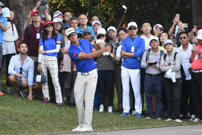 Rafa Cabrera Bello chips to the 13th green after a wayward 2nd shot, during round 3 of the UBS Hong Kong Open on Saturday Dec 10, 2016. (Bill Cox/Epoch Times)