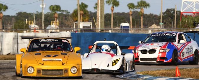 Cars spanning four decades round Turn Three at Sebring International Raceway. (Chris Jasurek/Epoch Times)