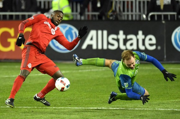 Seattle Sounders defender Chad Marshall and TorontoFCforward Jozy Altidore engage in one of their many battles at MLS Cup in Torontoon Dec. 10, 2016. (The Canadian Press/Frank Gunn)