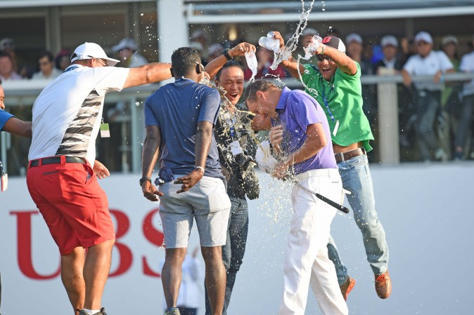 Sam Brazel gets a dousing with water after winning the UBS Hong Kong Open 2016 at Fanling on Sunday Dec 11, 2016. (Bill Cox/Epoch Times)