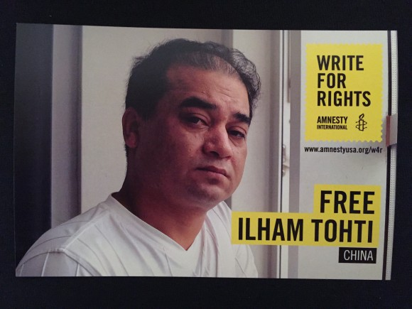 A postcard to raise awareness of prisoner of conscience Ilham Tohti in China at an Art for Amnesty event in Los Angeles, Calif. on Dec. 10. (Sarah Le/Epoch Times)
