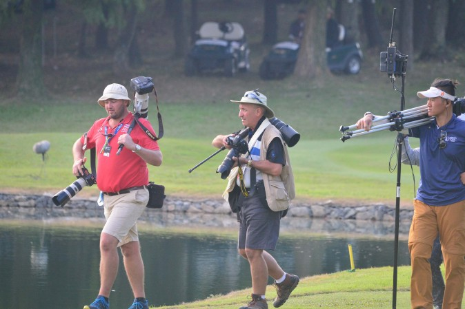 Photographers walking to the 18th green for the finale of the UBS Hong Kong Open on Sunday Dec 11, 2016. (Eddie So)