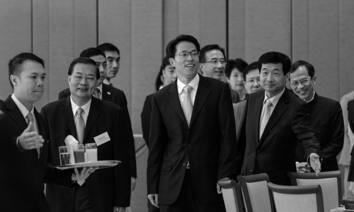 Zhang Xiaoming (C), the director of the China Liaison Office in Hong Kong, attends a luncheon with Hong Kong Legislative Council members and Beijing top officials in Hong Kong on July 16, 2013. (Philippe Lopez/AFP/Getty Images)
