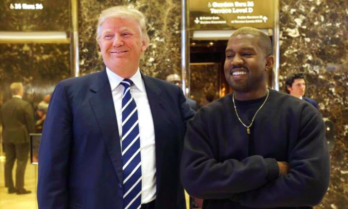 President-elect Donald Trump and Kanye West pose for a picture in the lobby of Trump Tower in New York, Tuesday, Dec. 13, 2016. (AP Photo/Seth Wenig)
