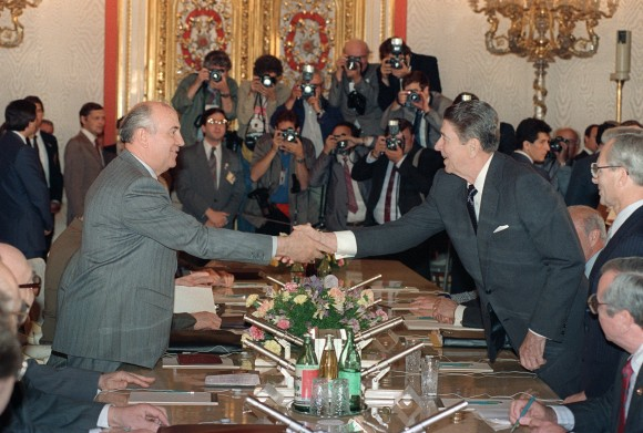 US President Ronald Reagan (R) shaking hands with Soviet leader Mikhail Gorbachev at St. Catherine's Hall, Kremlin Place prior to their last summit meeting on June 1, 1988. (MIKE SARGENT/AFP/Getty Images)