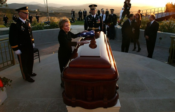 Former first lady Nancy Reagan leans into the casket of former President Ronald Reagan during the interment ceremony at the Ronald Reagan Presidential Library in Simi Valley, Calif. on Jun. 11, 2004. Reagan died of pneumonia due to complications with Alzheimer's at age 93 at his home in California. (Photo by Kevork Djansezian - Pool/Getty Images)