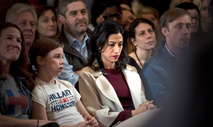 Huma Abedin, top Clinton aid, listens while Former Democratic US Presidential candidate Hillary Clinton speaks to supporters at the New Yorker Hotel after her defeat in the presidential election in New York on Nov. 9, 2016. (BRENDAN SMIALOWSKI/AFP/Getty Images)