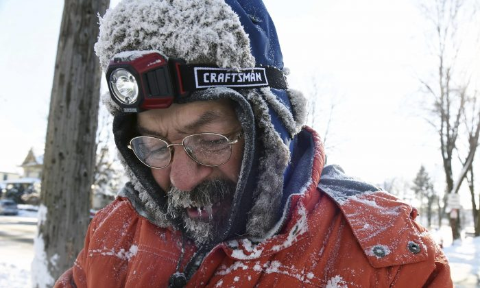Ice forms in Carl Bentson's beard and mustache as he clears sidewalks near Colborne Street and St. Clair Avenue in St. Paul, Minn, on Dec. 12, 2016. (Scott Takushi  /Pioneer Press via AP)
