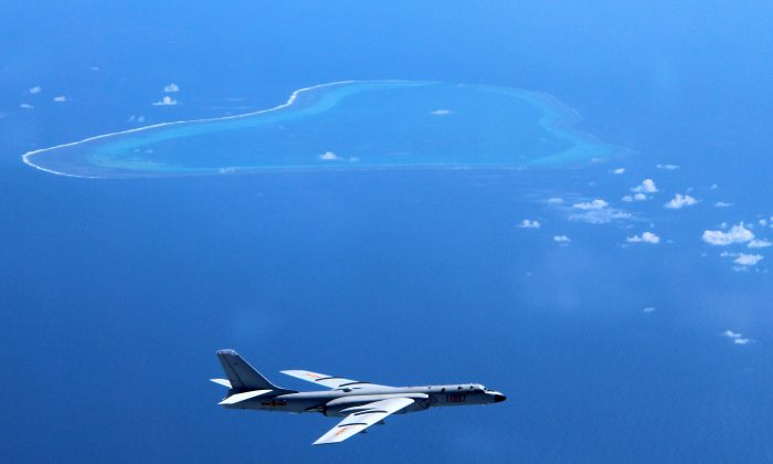 A Chinese H-6K bomber patrols the islands and reefs in the South China Sea, in this file photo. (Liu Rui/Xinhua via AP)