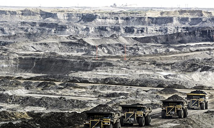 Mining trucks at the Albian Sands near Fort McMurray, Alberta, Canada, on Aug. 5, 2005.