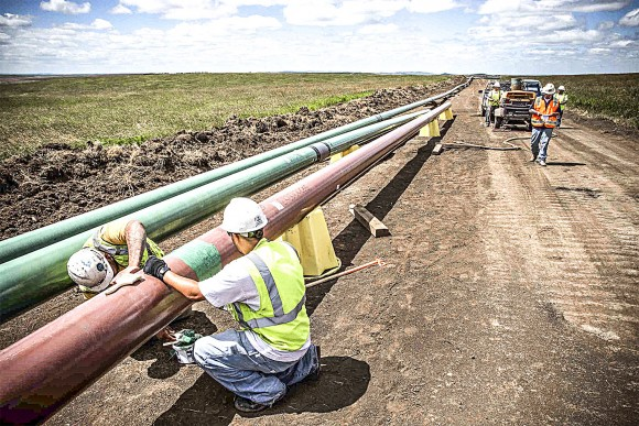 Construction workers on a section of the Dakota Access Pipeline outside Watford City, N.D., on July 25, 2013. (Andrew Burton/Getty Images)