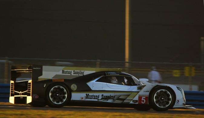 The #5 Action Express Cadillac DPi V.R. gets in a few final laps as the sun sets Tuesday, Dec. 13. (Chris Jasurek/Epoch Times)