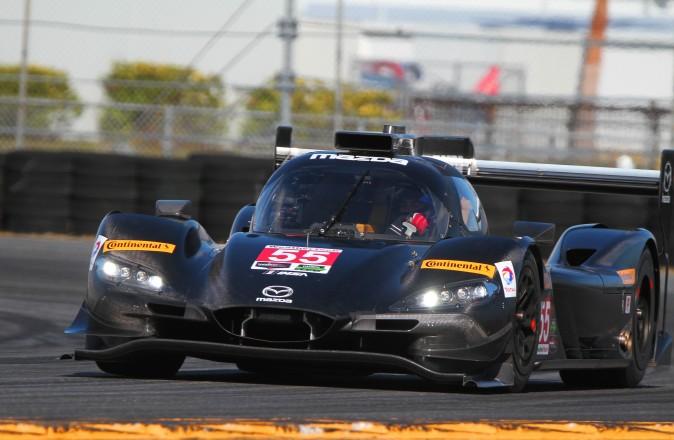 Mazda's Riley-based RT24-P rounds the International Horseshoe at Daytona International Speedway during IMSA's WSC test, Dec 13–14, 2016. (Chris Jasurek/Epoch Times)