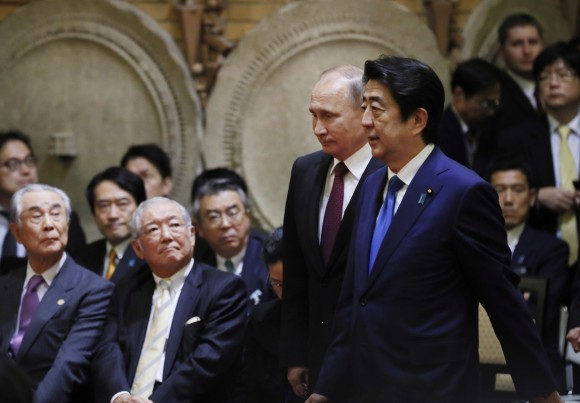 Japanese Prime Minister Shinzo Abe, right, walks with Russian President Vladimir Putin during a joint press conference in Tokyo, Japan, on Dec. 16, 2016. (AP Photo/Alexander Zemlianichenko, Pool)