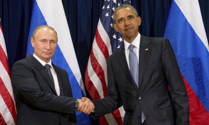 U.S. President Barack Obama (R) and Russia's President President Vladimir Putin pose for members of the media before a bilateral meeting at the United Nations headquarters, in this file photo. (AP Photo/Andrew Harnik)