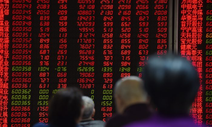 Investors watch price movements on screens in Beijing Feb. 22. China's insurance regulator said risky stock market bets by domestic insurers undermines market stability. (Greg Baker/AFP/Getty Images)