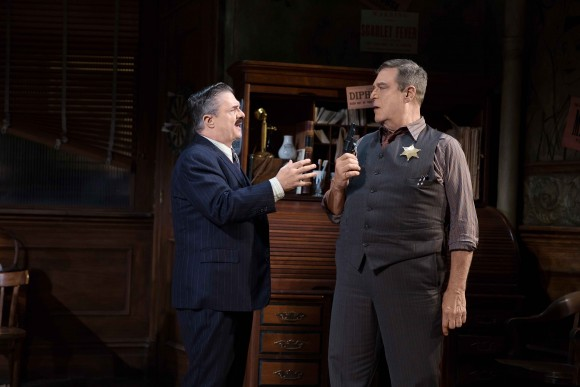 (L–R)  Newspaperman Walter Burns (Nathan Lane) realizes that Sheriff  Hartman (Dan Goodman) framed a man, who was then convicted of killing a police officer, just so Hartman could be reelected. (Julieta Cervantes)