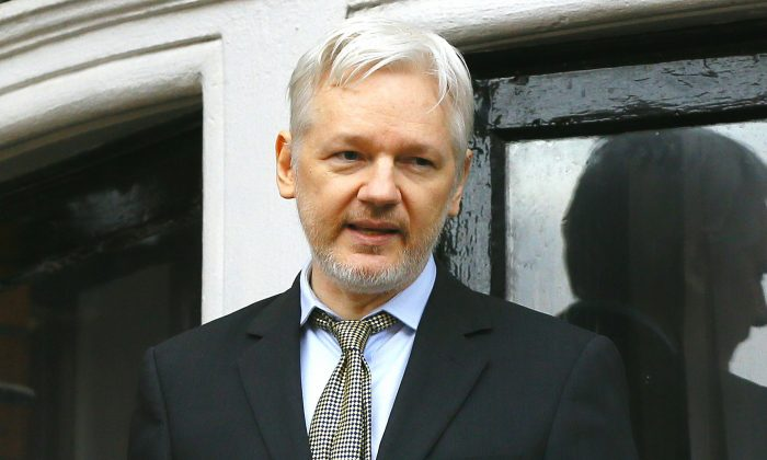 WikiLeaks founder Julian Assange speaks from the balcony of the Ecuadorean Embassy in London, in this file photo. (AP Photo/Kirsty Wigglesworth)
