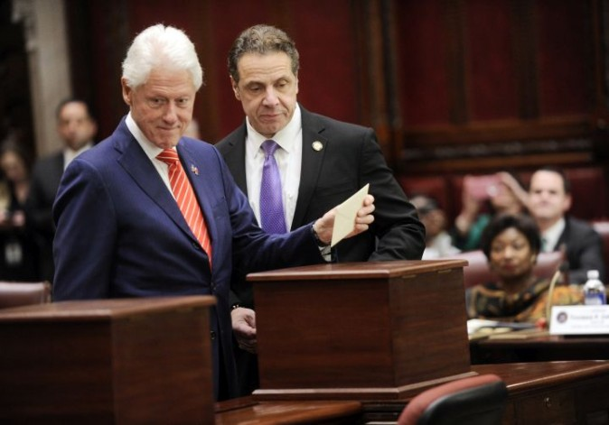 Former President Bill Clinton, left, and New York Gov. Andrew Cuomo, of New York state's Electoral College cast their ballots for Hillary Clinton in the Senate chambers of the Capitol in Albany, N.Y., Monday, Dec. 19, 2016. (AP Photo/Hans Pennink, Pool)