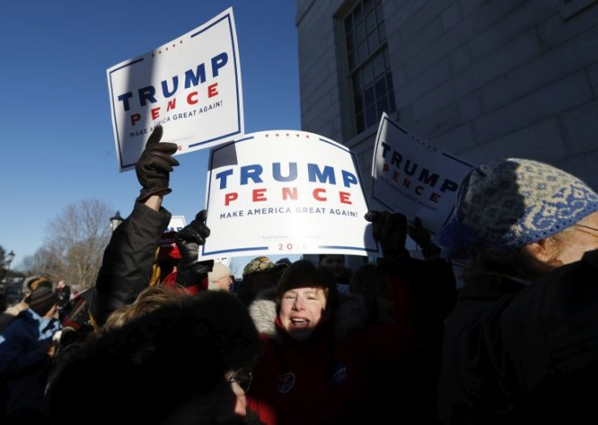 A supporter of President-elect Donald Trump shouts back at anti-Trump protesters outside the state Capitol in Augusta, Maine, Monday, Dec. 19, 2016. Maine's electoral college voters split their vote with 3 ballots for cast for Hillary Clinton and one for Trump. (AP Photo/Robert F. Bukaty)