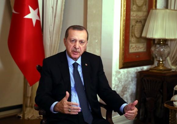 Turkey's President Recep Tayyip Erdogan, talks regarding the Russian ambassador Andrei Karlov's assassination at the Presidential palace in Ankara, Turkey, on Dec. 19, 2016. (Press Presidency Press Service via AP, Pool)