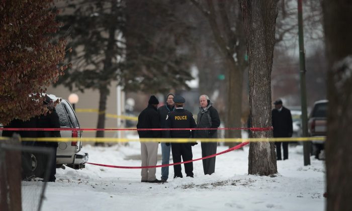 Police investigate the scene of a quadruple homicide on the city's southside on Dec. 17, 2016 in Chicago, Illinois.(Scott Olson/Getty Images)