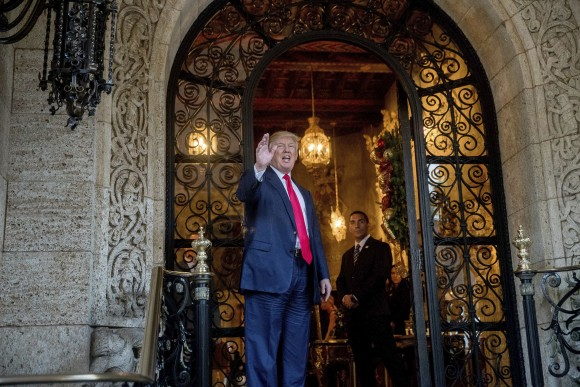 President-elect Donald Trump waves to members of the media after a meeting with admirals and generals from the Pentagon at Mar-a-Lago, in Palm Beach, Fla., on Dec. 21, 2016. (AP Photo/Andrew Harnik)