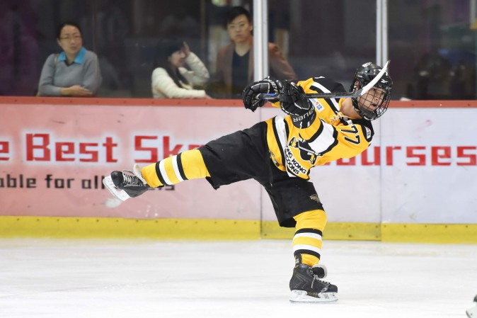 Leading goal scorer Lucas Eshleman of Hong Kong Tycoons with a typical shot at goal during their CIHL match at Mega Ice on Dec 15, 2016. (Bill Cox/Epoch Times)